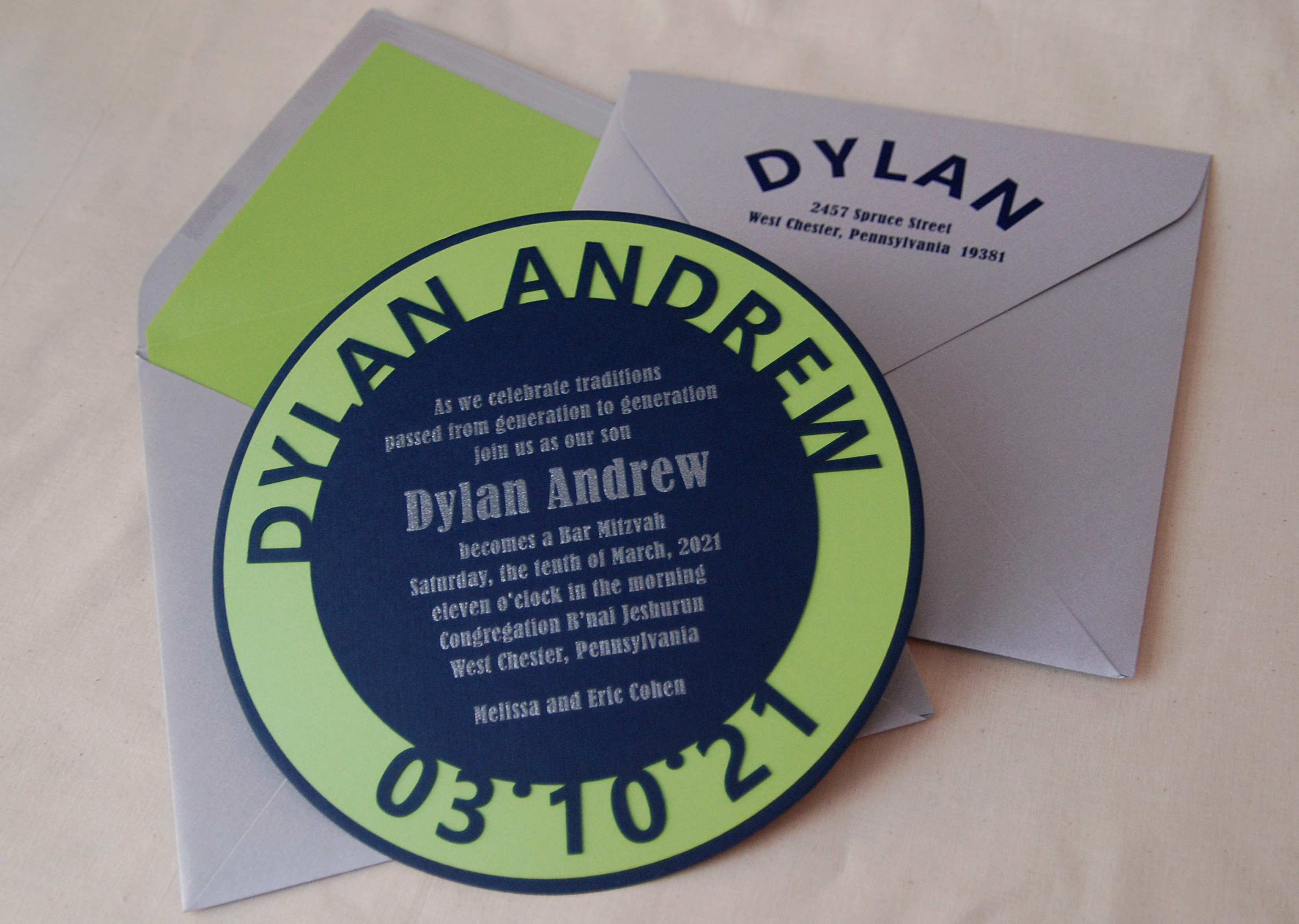 Dylan Andrew Circle Lasercut name and date layered bar mitzvah invitation in navy and green with silver.