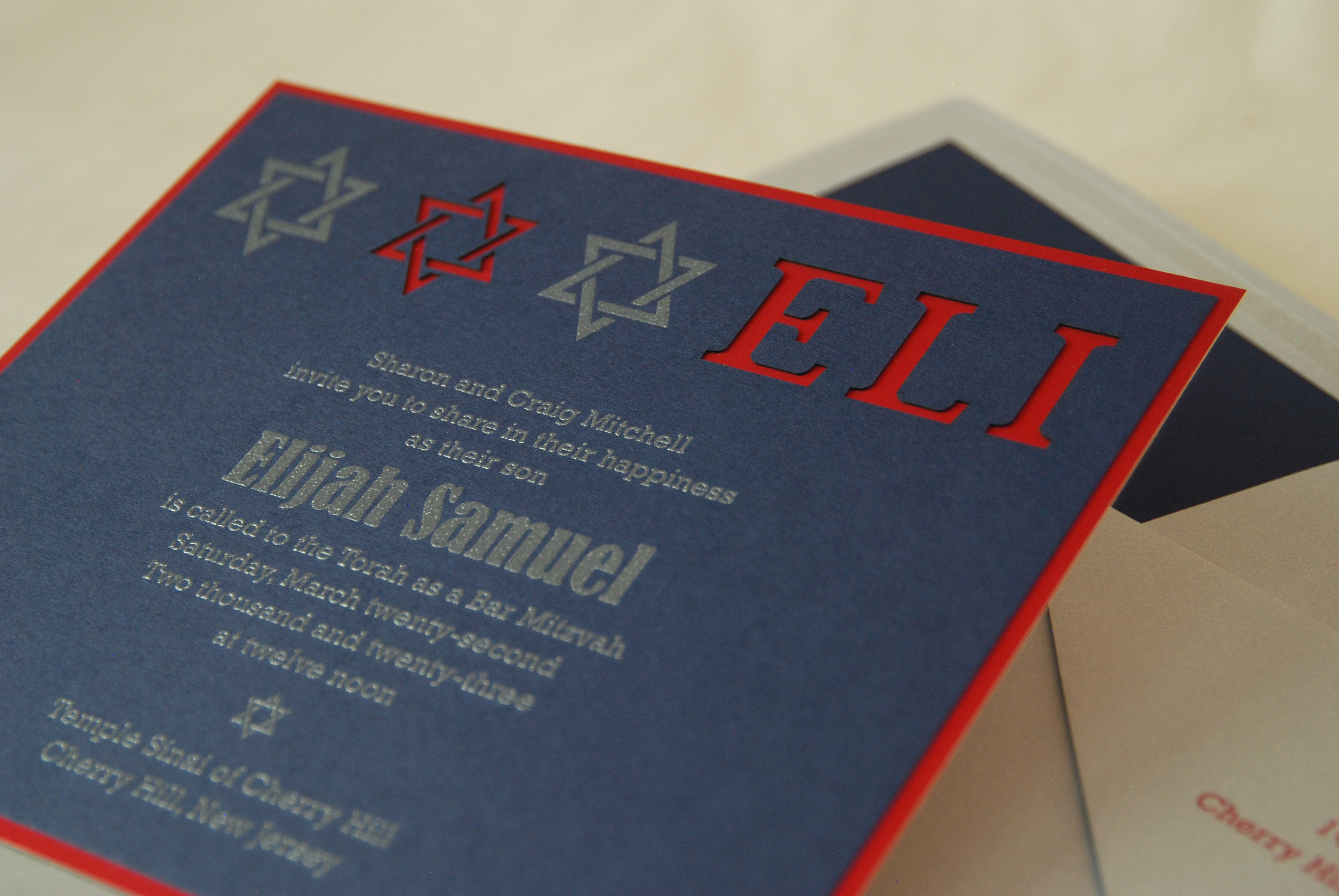 Elijah Samuel laserut blue, red, and silver bar mitzvah invitation available in Northern Virginia at Staccato.