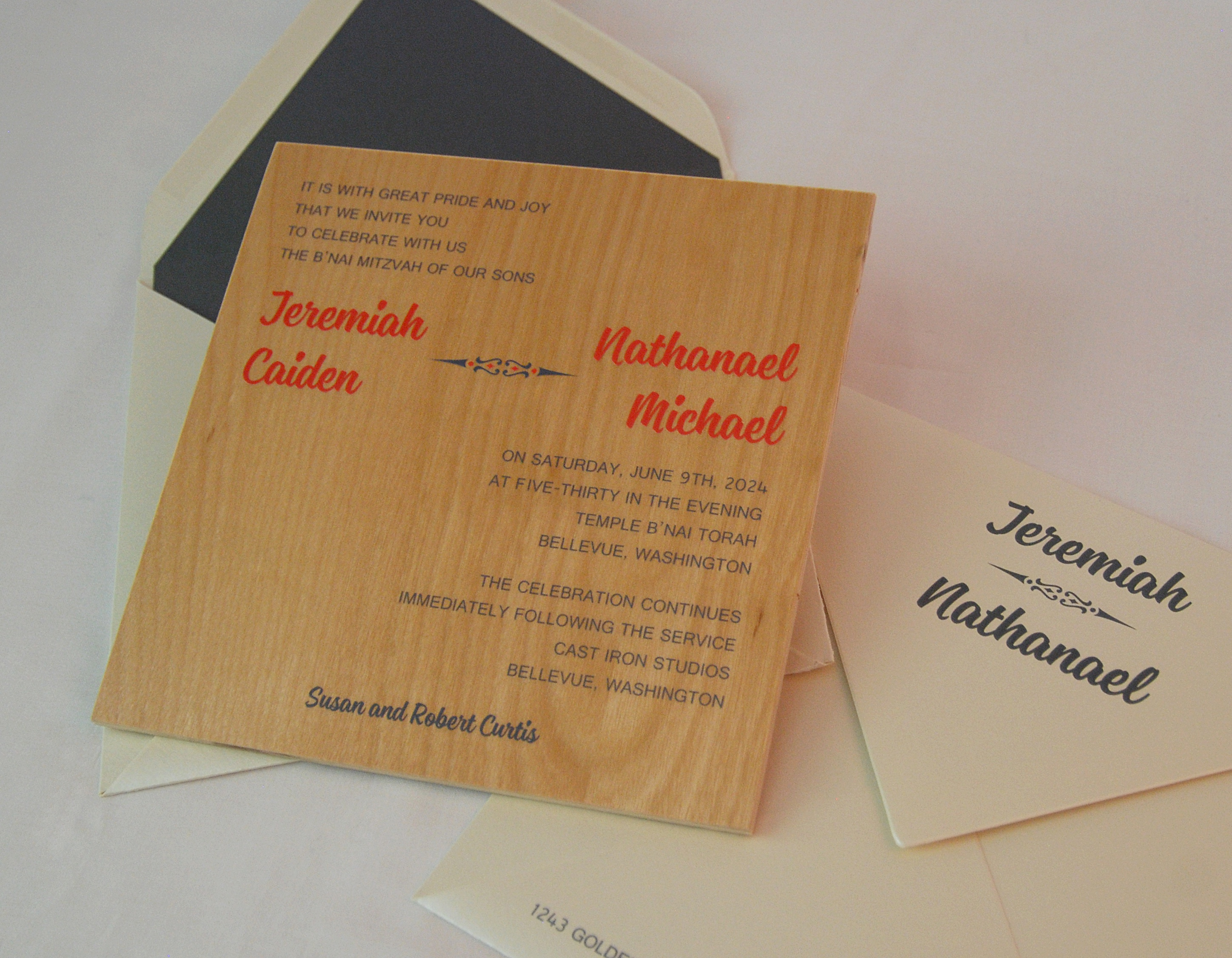 Jeremiah & Nathanael B'nai mitzvah invitation can easily work as a solo bar mitzvah invitation.  Wooden board is screen printed in red and navy.
