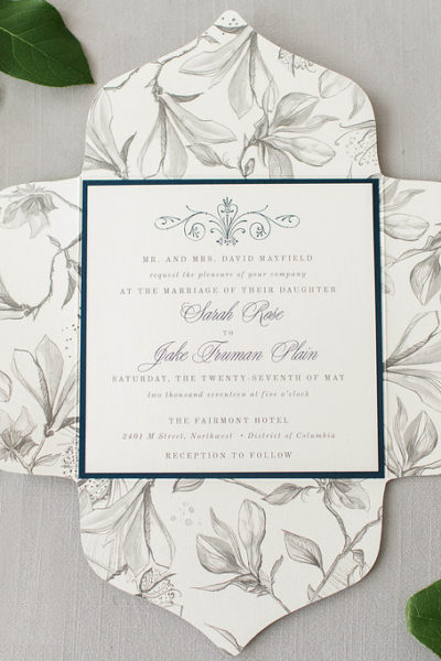 hopeless romantic wedding invitation with gray sketched magnolia flowers and navy blue accents.