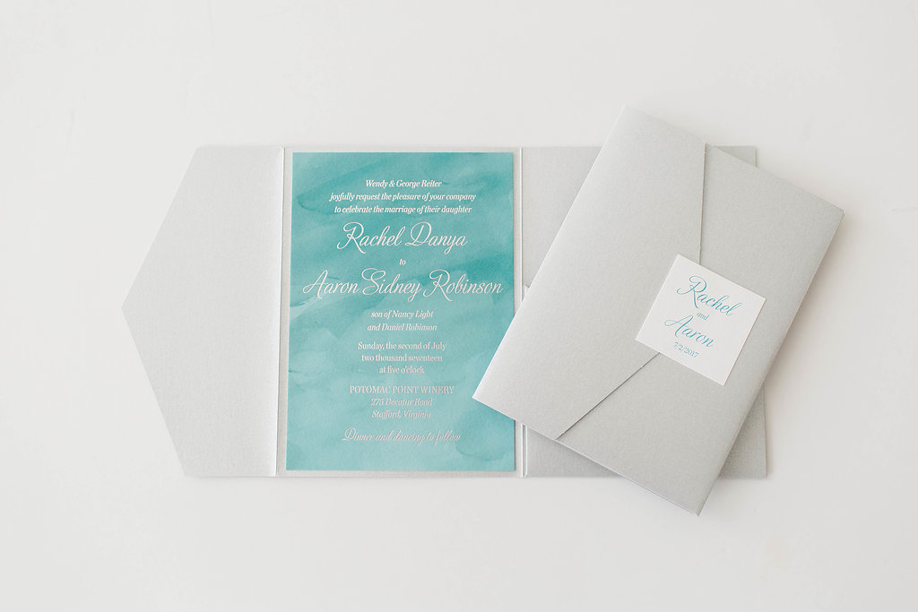 turquoise and silver foil watercolor pocketfold wedding invitation.