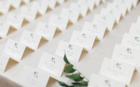 custom escort card display with greenery