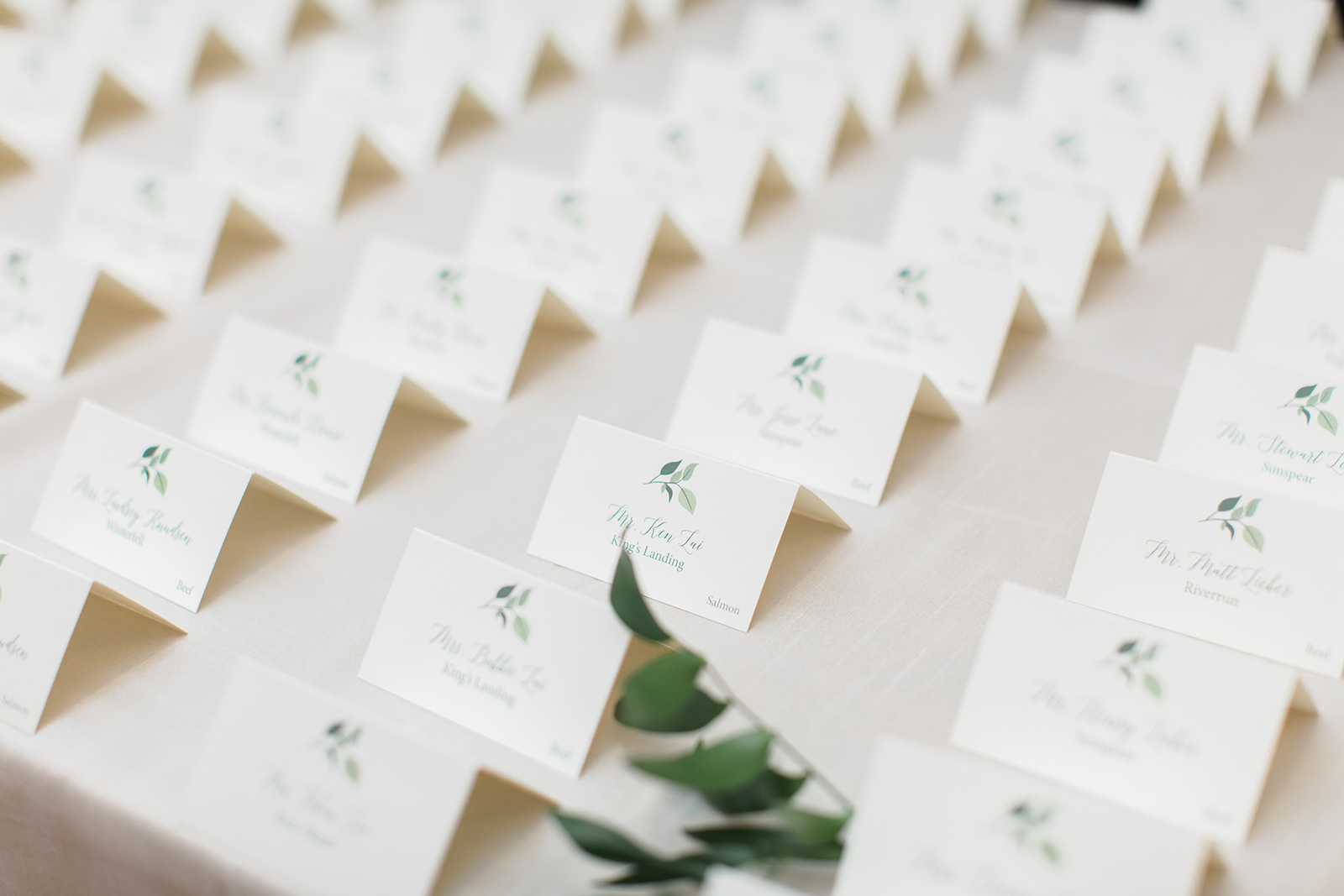 custom escort card display with greenery