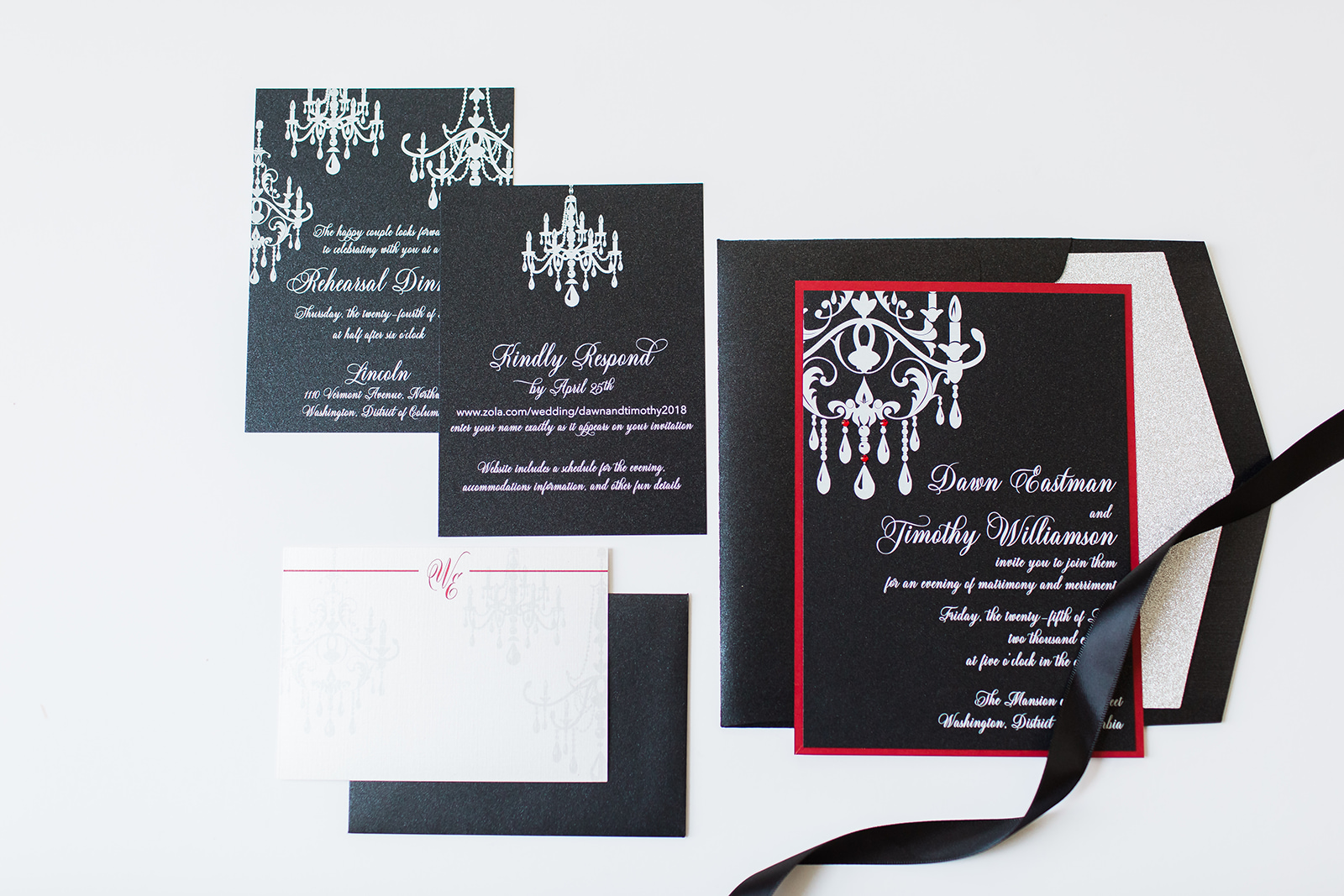 custom wedding invitations in black, white, and red with a rhinestone embellished chandelier