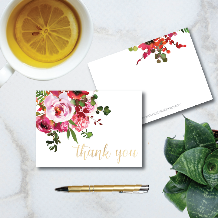 """Beautiful pink and raspberry floral motif accents gold foil """"thank you"""" sentiment in a pretty calligraphy script. 4-bar sized folded note cards are blank inside and come with envelopes."""