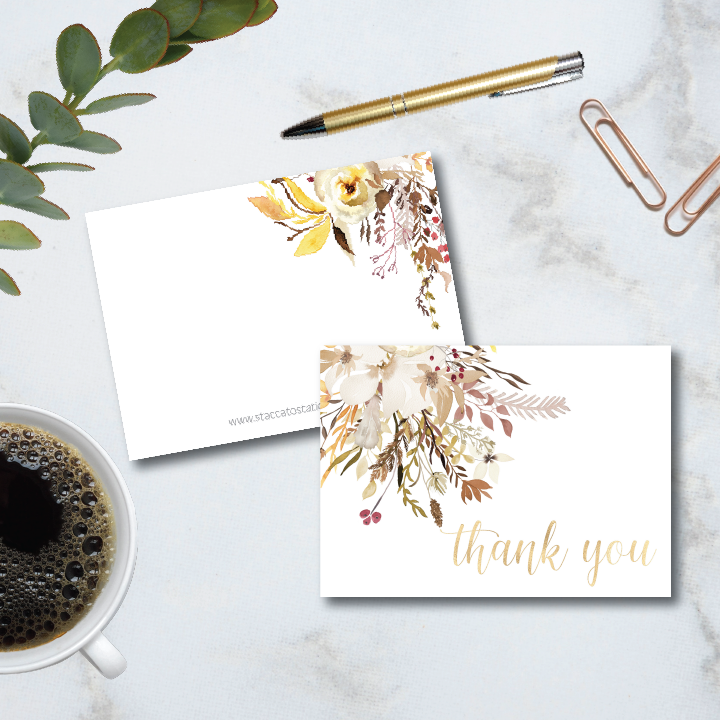 """beautiful shades of autumn flowers accent a gold foil """"thank you"""" sentiment on this folded 4-bar thank you note card. Set comes with blank envelopes"""