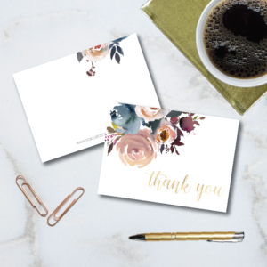 "beautiful indigo and blush flower motif graces the corner of this folded note card with gold foil ""thank you"" sentiment in a beautiful script. 4-bar sized cards come with matching envelopes."
