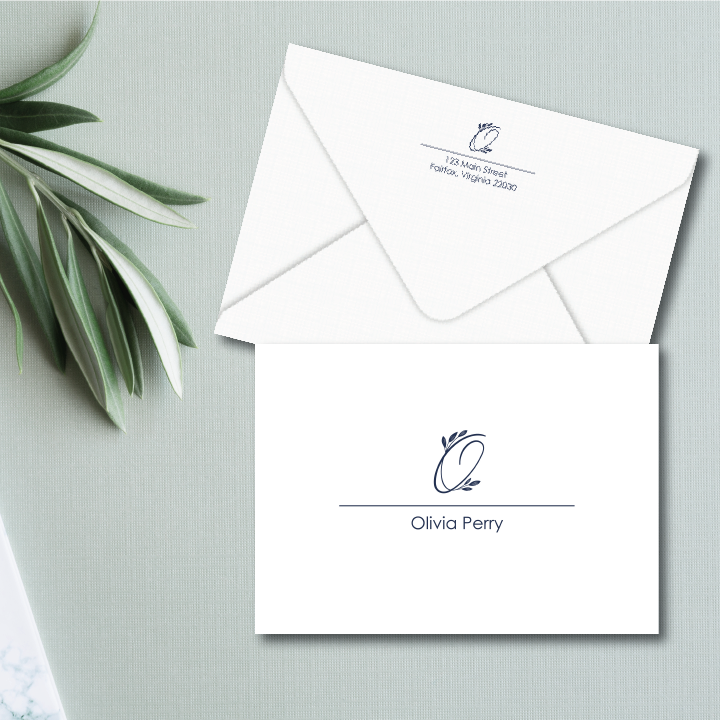 A monogram of beautiful leaf-embellished script sits atop a full name on the front of this personalized folded note card.