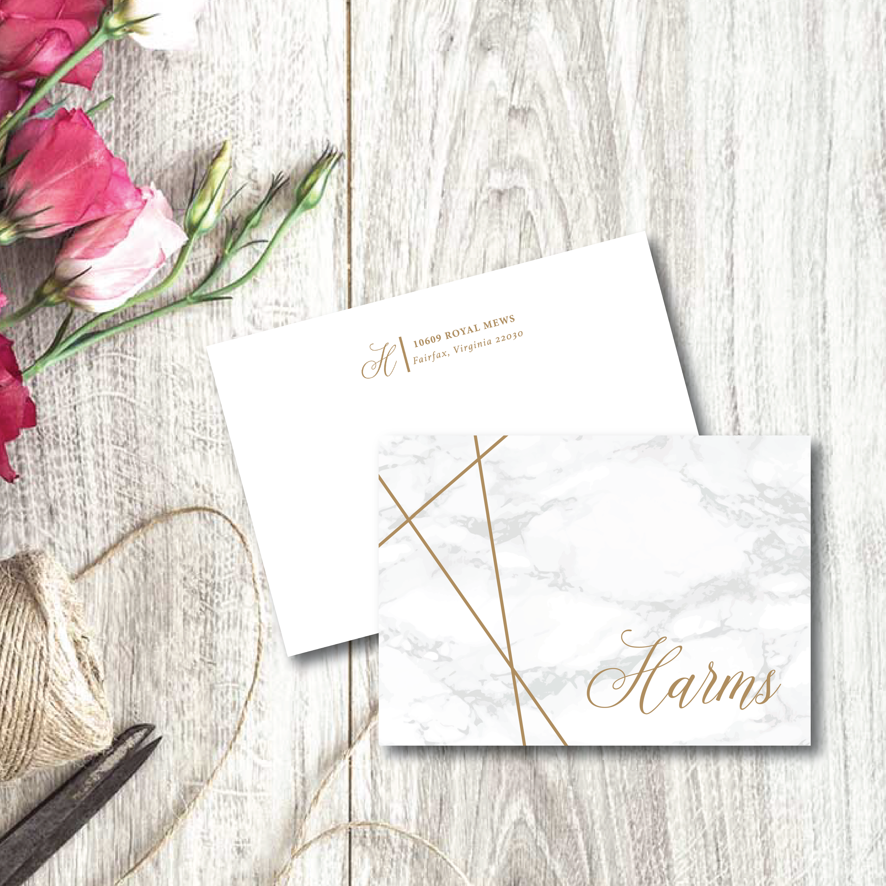 marble background, gold stripes and personalized name in a calligraphy script grace the front of these 4-bar folded note cards that can come with personalized envelopes.
