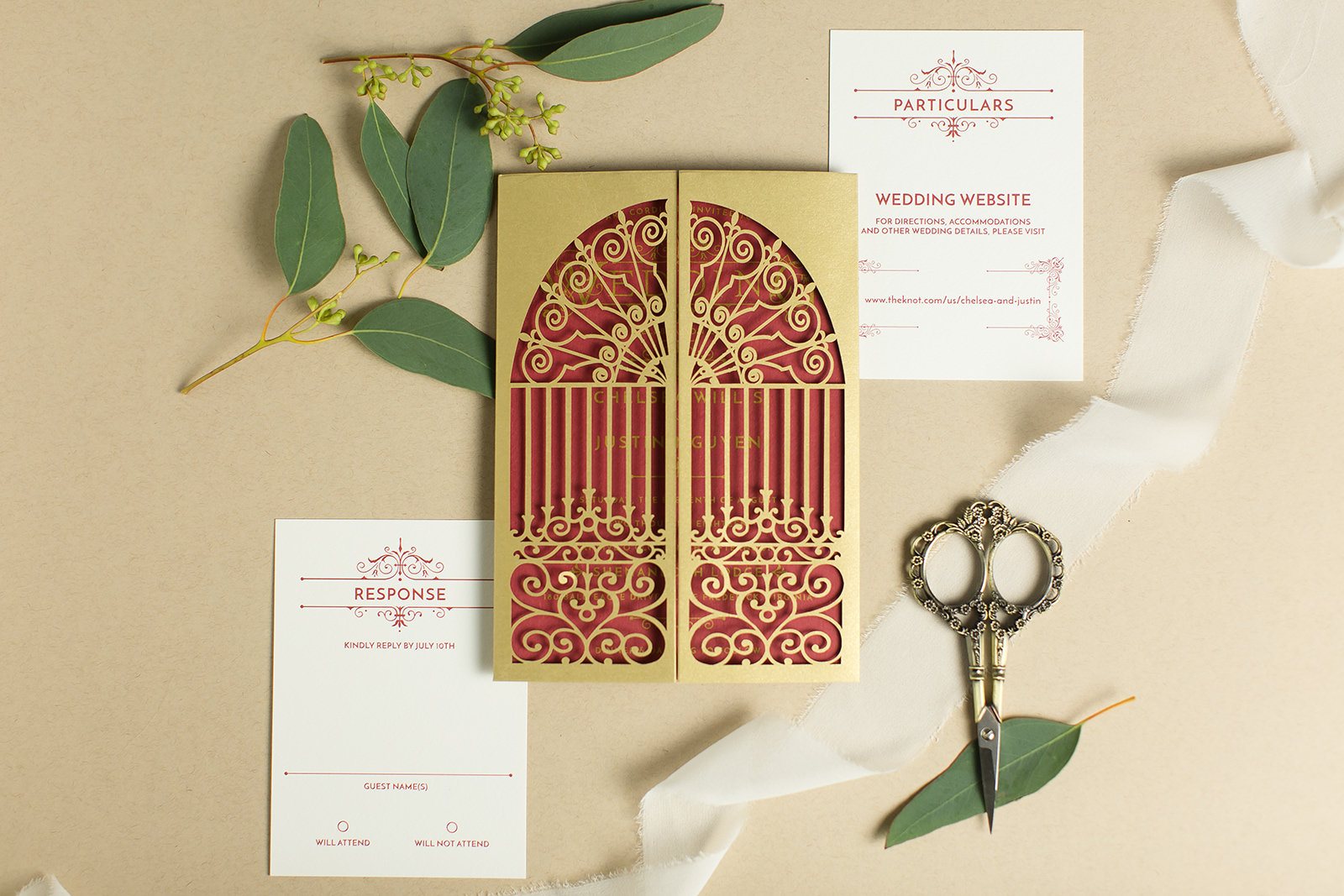 Custom wedding invitations Fairfax, Virginia.  Magical wedding invitation features gold flat printing on red card presented in a gold lasercut gate.