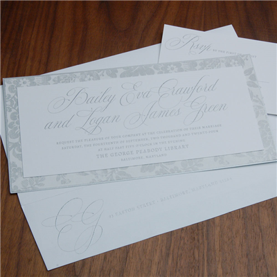 Athenaeum wedding invitation by Checkerboard features beautiful silver patterned paper behind a contemporary silver thermography invitation.