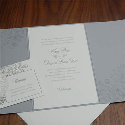 Rosemary Gatefold Wedding Invitation by Checkerboard features a beautiful printed wrap with a delicate floral motif.