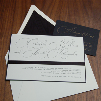 Foundry wedding invitation features a pretty satin ribbon band below modern script names.