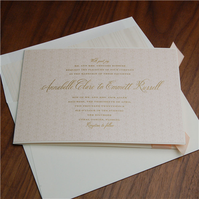 Biltmore Wedding Invitation by Checkerboard features gold thermography on a pretty blush card layered into a ribbon-accented pocketfolio