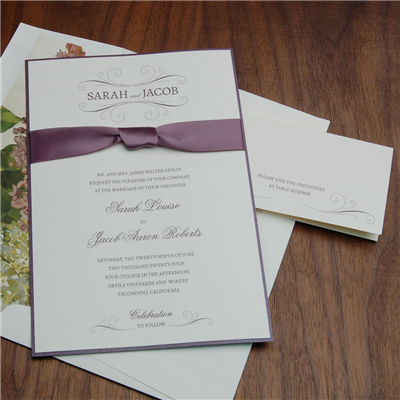 Aromatic Wedding Invitation by Checkerboard features pretty satin ribbon tied in a knot.