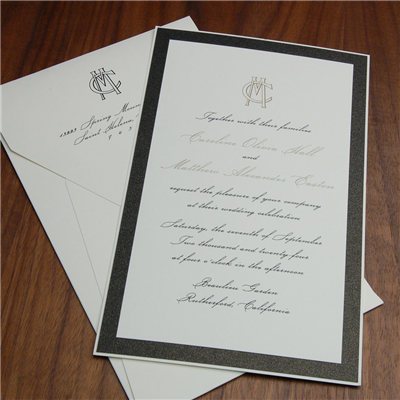Bittiglia layered wedding invitation by Checkerboard features a classic monogram and two colors of thermography