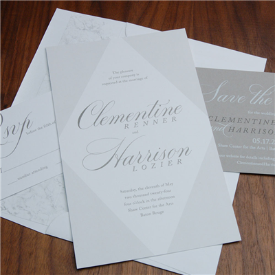 Luna wedding invitation features bold geometric lines in a diamond shape with accented names.