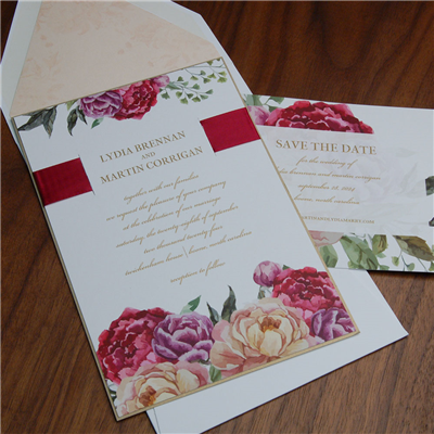 Penelope wedding invitation by Checkerboard features pretty floral design and a satin ribbon.