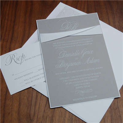 Contemporary wedding invitation by Checkerboard features gray paper with white thermography and white satin ribbon accent.
