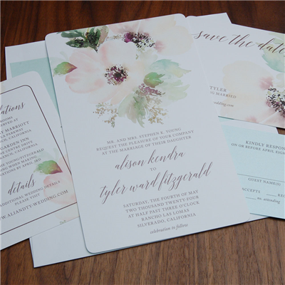 Tivoli wedding invitation by Checkerboard features a beautiful blush floral pattern and modern calligraphy script
