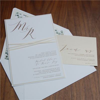 Tranquil wedding invitation by Checkerboard features beautiful layers and a satin ribbon accent.