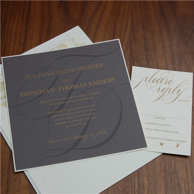 Quill wedding invitation by Checkerboard is a dramatic gold thermography on dark gray card with a large monogram watermarked in the background.