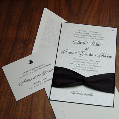 Modica wedding invitation by Checkerboard features a delicate background and a bold ribbon accent.