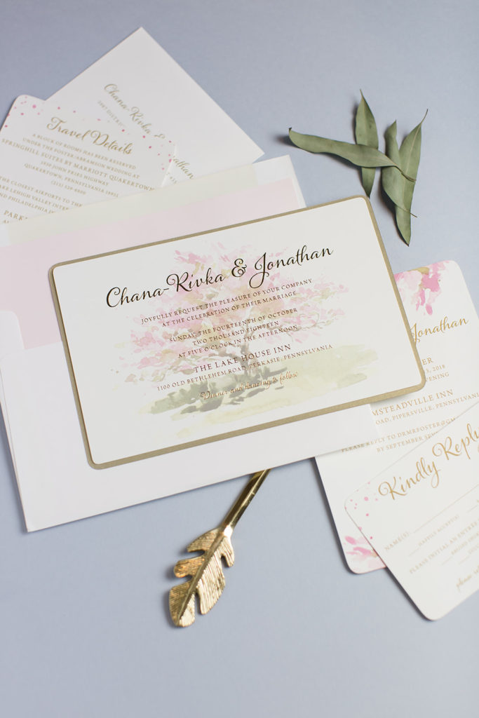 watercolor cherry blossom tree on a gold foil wedding invitation.