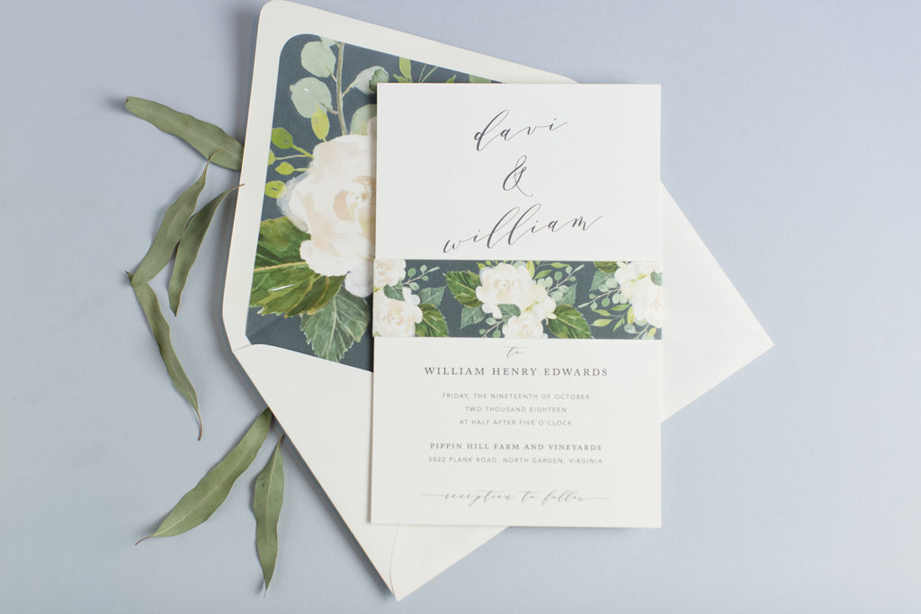 Floral envelope liner and belly band are the perfect accents to this contemporary wedding invitation.