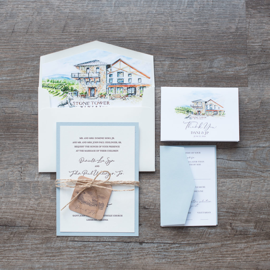 watercolor painting of stone tower winery is highlighted in this beautiful envelope liner.  A wooden tag with a sketch of Stone Tower Winery is printed onto a real wooden tag tied around the layered letterpress wedding invitation with twine.