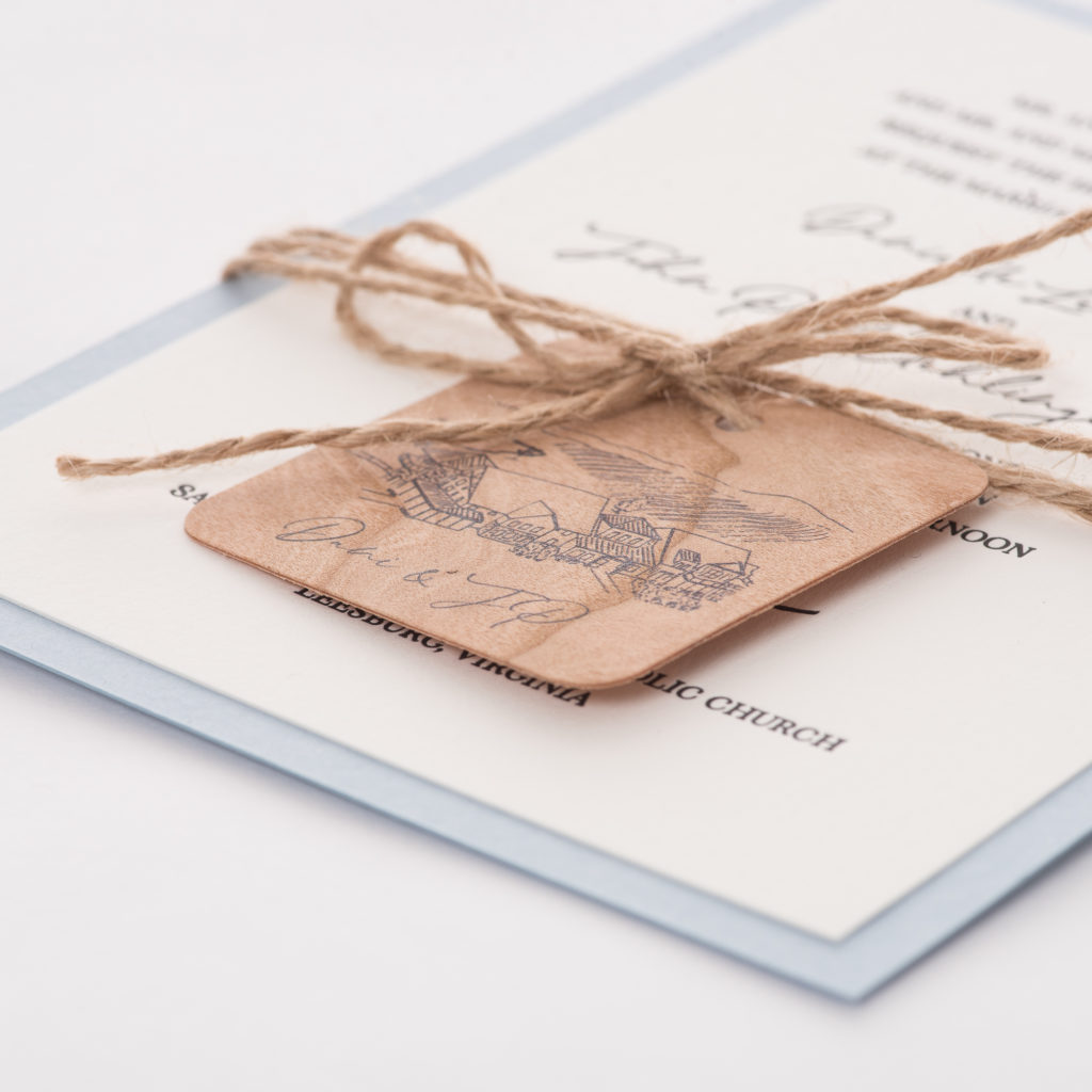 line drawing and watercolor images of stone tower winery wedding venue are featured on these custom layered, letterpress wedding invitations with wooden tag and twine,