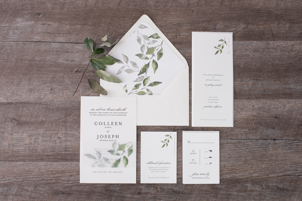Stunning letterpress invitation features leafy greenery printed on a wide vellum wrap (belly band) and cascading down the pretty envelope liner and embellishing the inserts. A stunning modern twist on a classic invitation available in Fairfax, Virginia at Staccato.