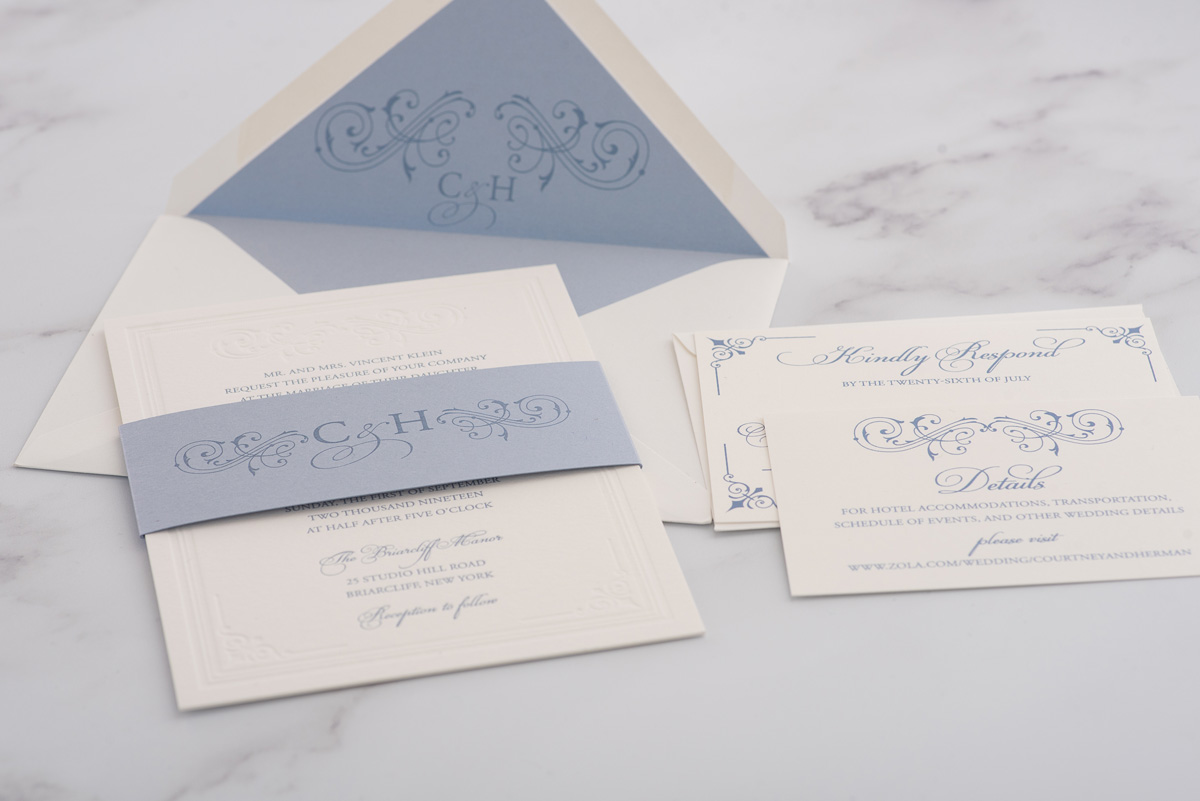A beautiful combination of slate blue and blind letterpress created a stunning double thick wedding invitation.