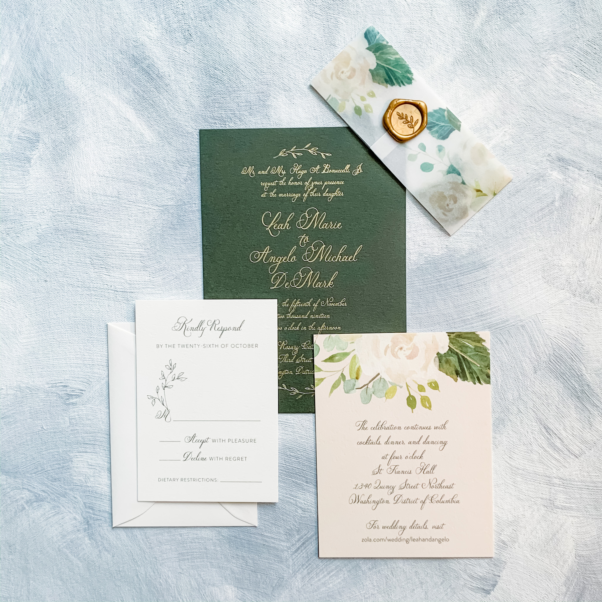 Green card with gold foil stamping makes a bold statement that is softened by a pretty blush floral print vellum belly band and gold wax seal.