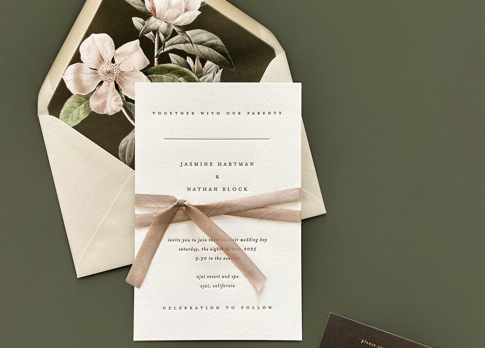 Simple letterpress invitation is embellished with a hand-dyed silk ribbon and accented with a pretty floral pattern on insert and envelope liner.