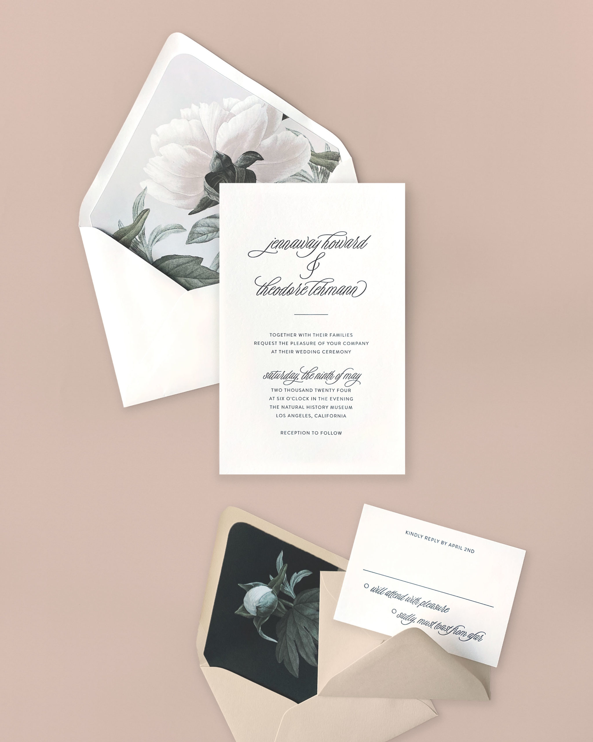 modern letterpress wedding invitation is accented by a floral envelope liner in subtle shades of gray and dusty botanicals.