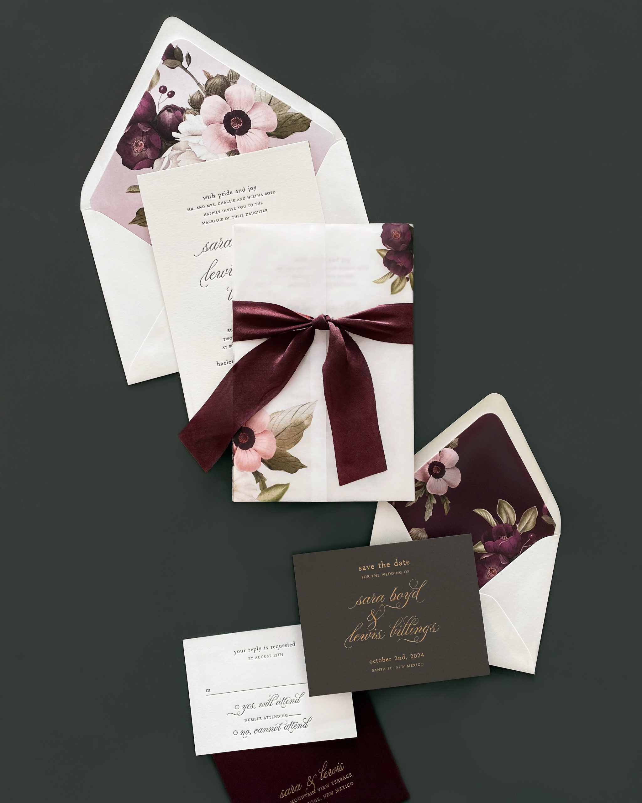 romantic floral spray in blush and burgundy accents this stunning letterpress wedding invitation that features a vellum band, hand-dyed silk ribbon, and a beautiful envelope liner.