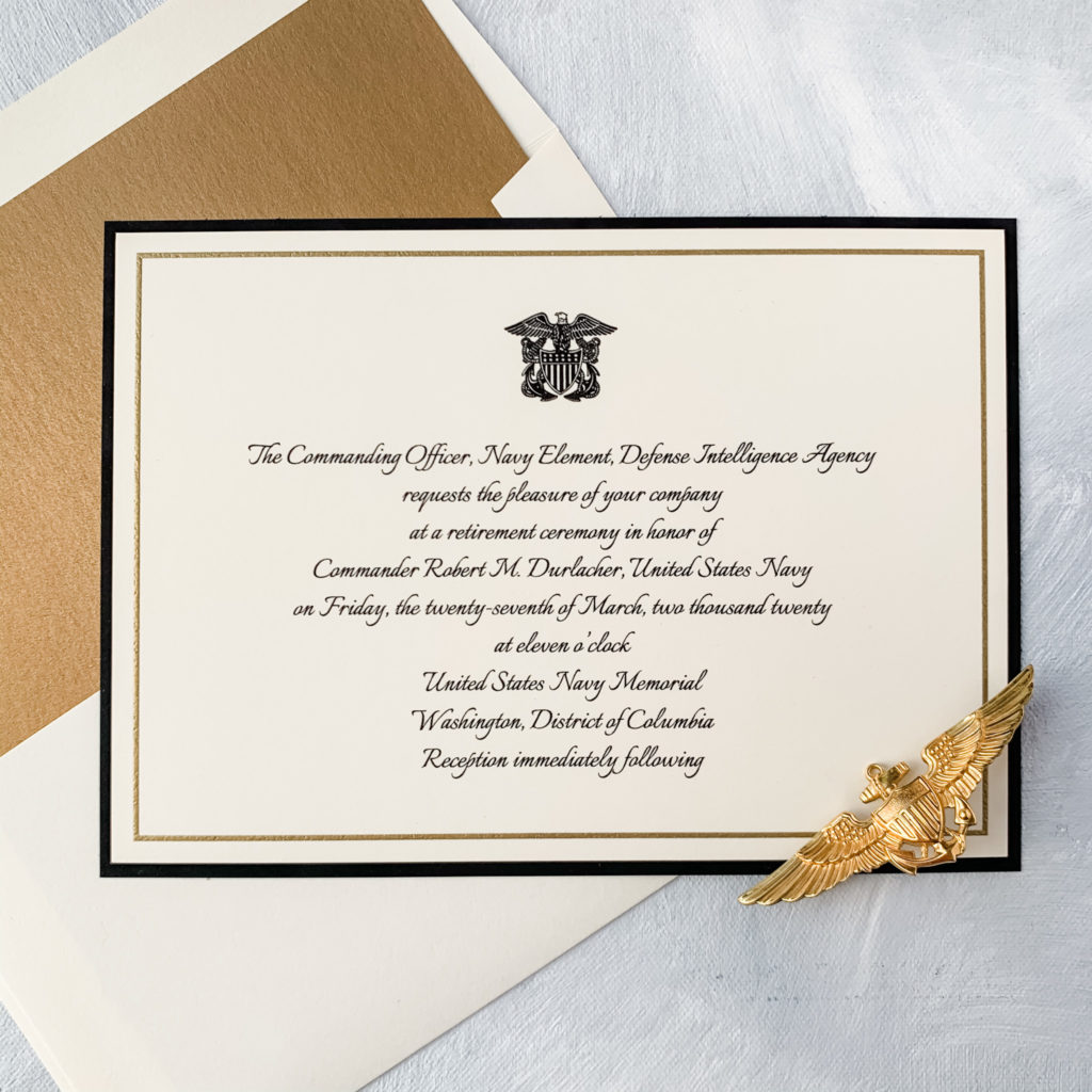 Naval officer retirement invitation features officer's crest and a black backing layer. Gold and black thermography printing are accented by a gold envelope liner.