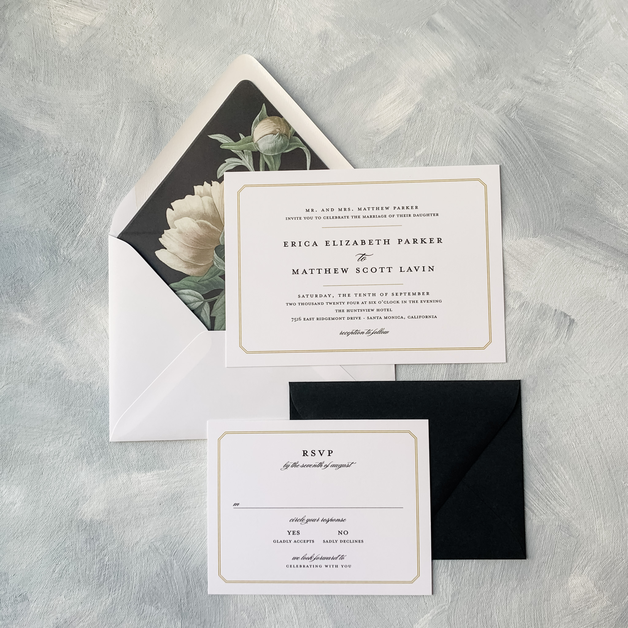 Modern horizontal wedding invitation features a romantic peony envelope liner.
