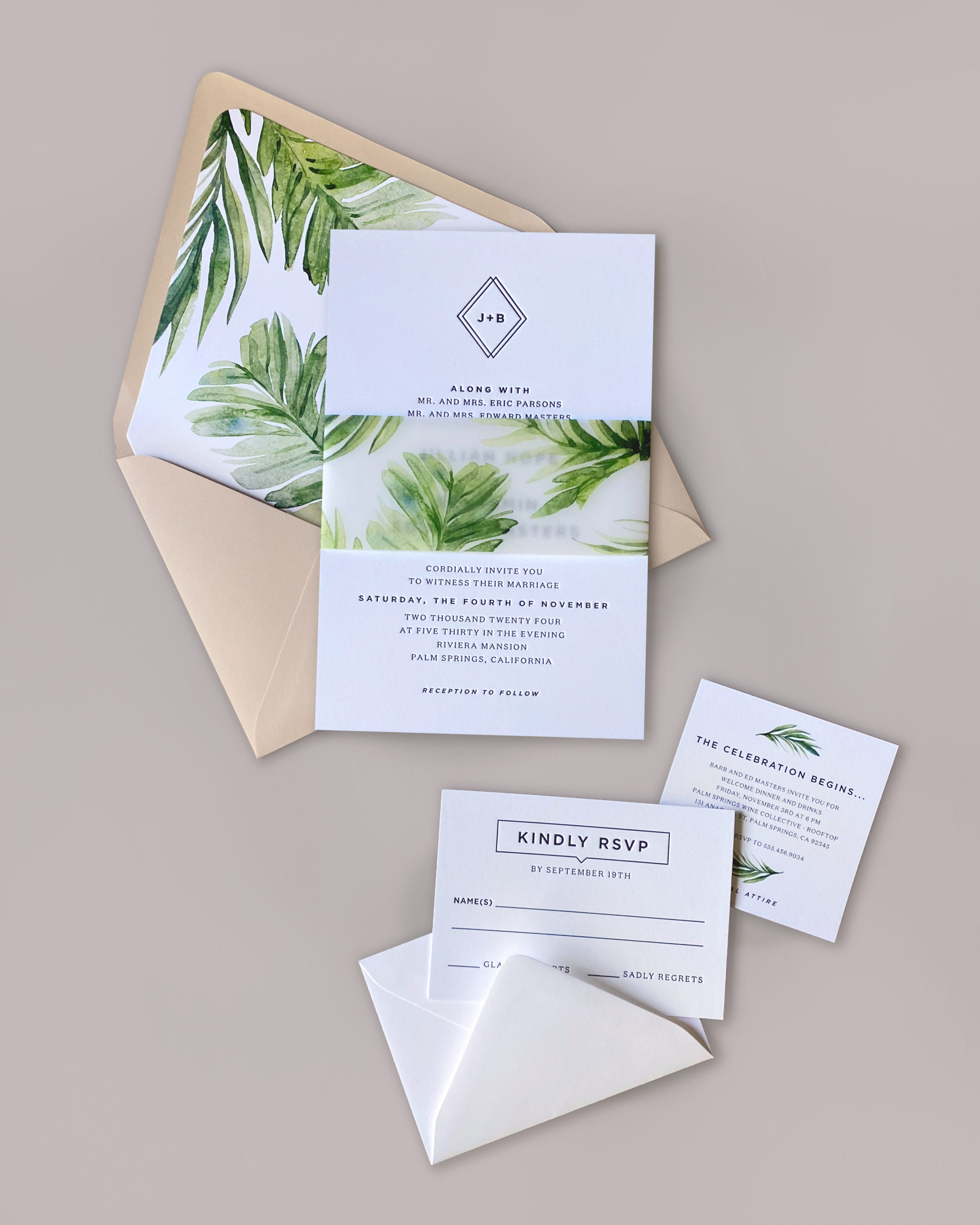 Jillian invitation features vellum band with palm fronds around a modern, traditional letterpress wedding invitation.  Available in Northern Virginia at Staccato.
