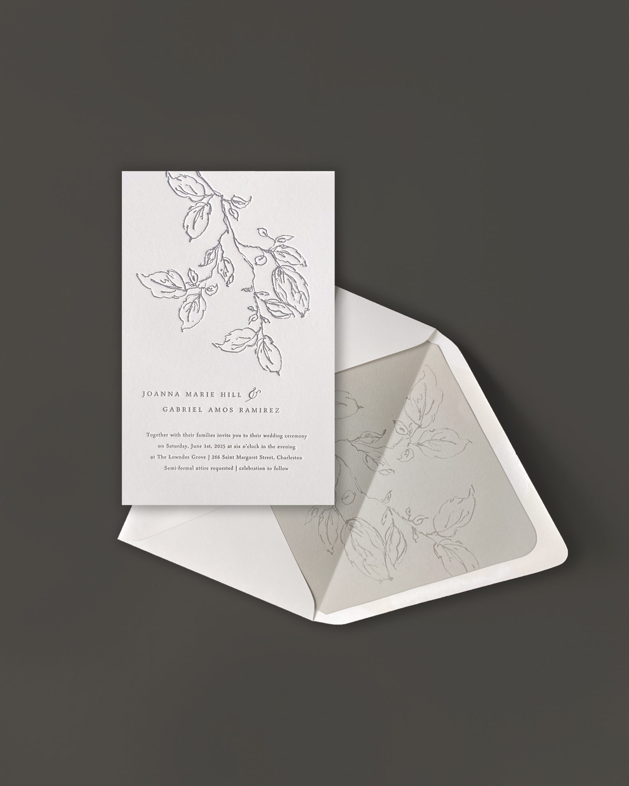 dramatic floral sketch cascades down from the top of this stunning, modern  letterpress wedding invitation.  Shown in earth tones, but available in any color scheme, this invitation is sure to wow your guests.  Available in the Washington DC area at Staccato.