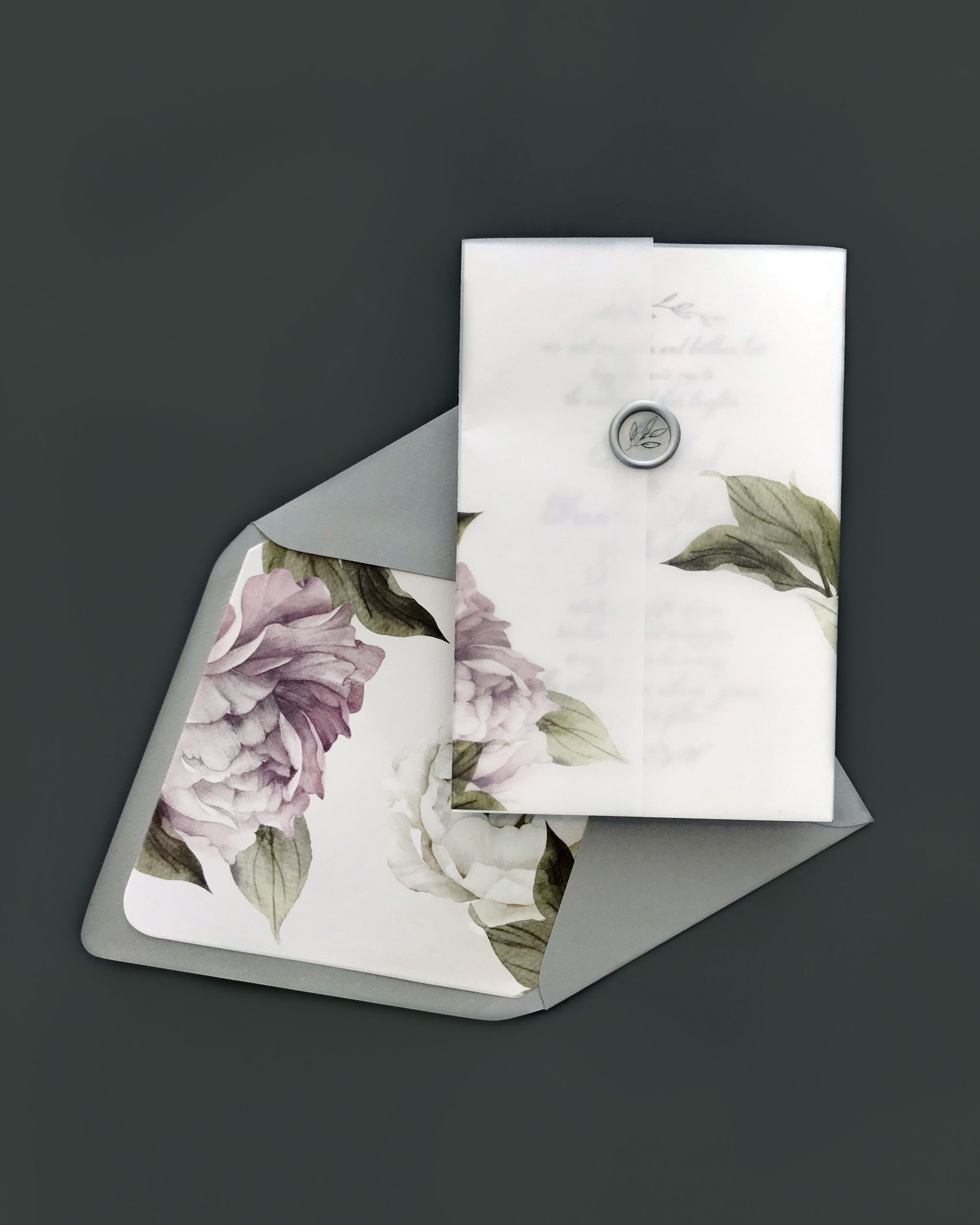 wrapped in floral printed vellum closed with a wax seal, this feminine wedding invitation is right on trend! The Smitten on Paper collection is available at Staccato in Fairfax, Virginia.