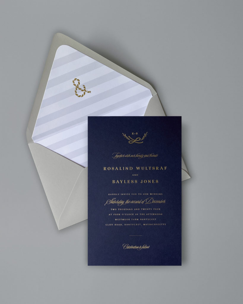 A sweet little sailors knot adorns this navy blue wedding invitation foil stamped in gold.  A pretty striped liner is the perfect accent for the seaside appropriate invitation.  Whether tying the knot on a sailboat or at a marina, let this dramatic invitation set the perfect tone!