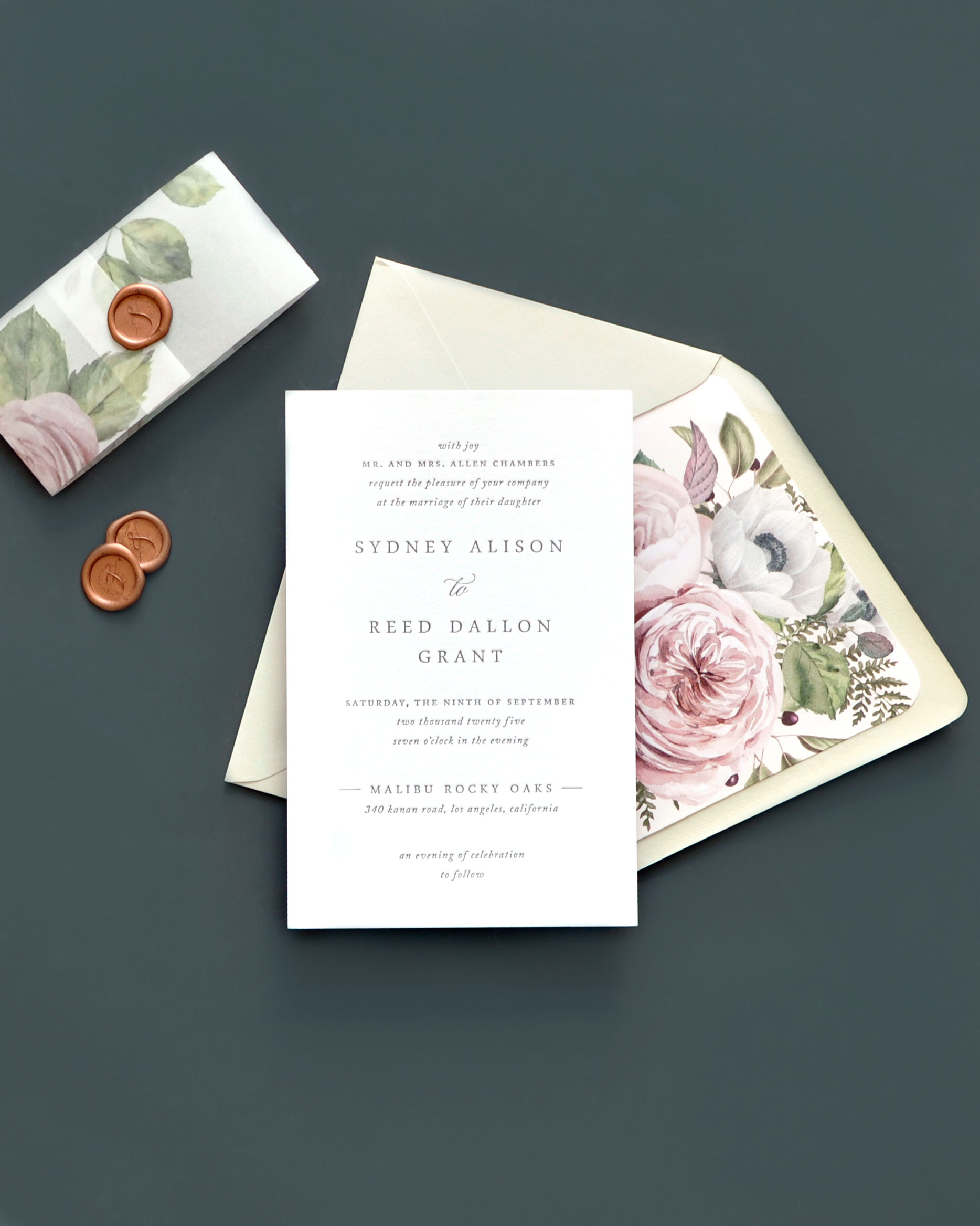 Beautiful floral envelope liner and printed vellum band are a stunning compliment to this modern-yet-traditional wedding invitation.  The letterpress invitations by Smitten on Paper are available in Fairfax, VA at Staccato.