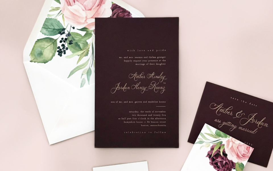 burgundy wine colored invitation with gold foil stamping and floral envelope liner featured on this luxury wedding invitation from Staccato in Northern VA