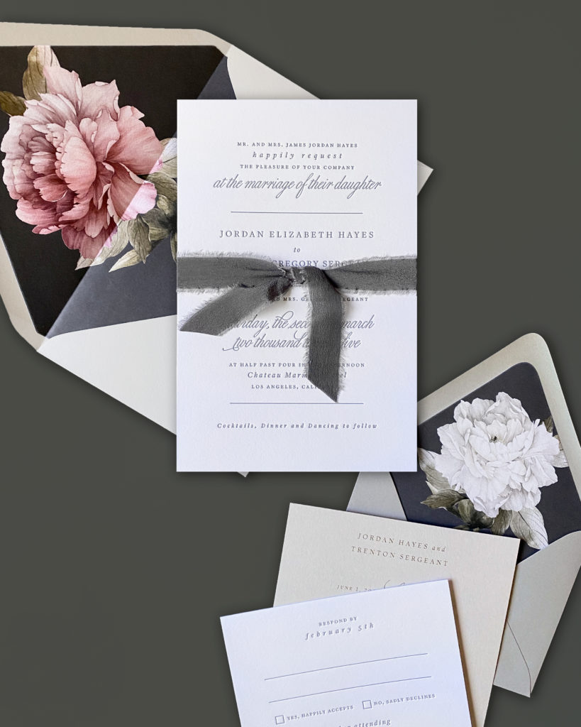 Luxury wedding invitation features modern fonts in gray letterpress and a dramatic floral envelope liner.  Smitten on Paper wedding invitations are available in the DC metro area at Staccato.