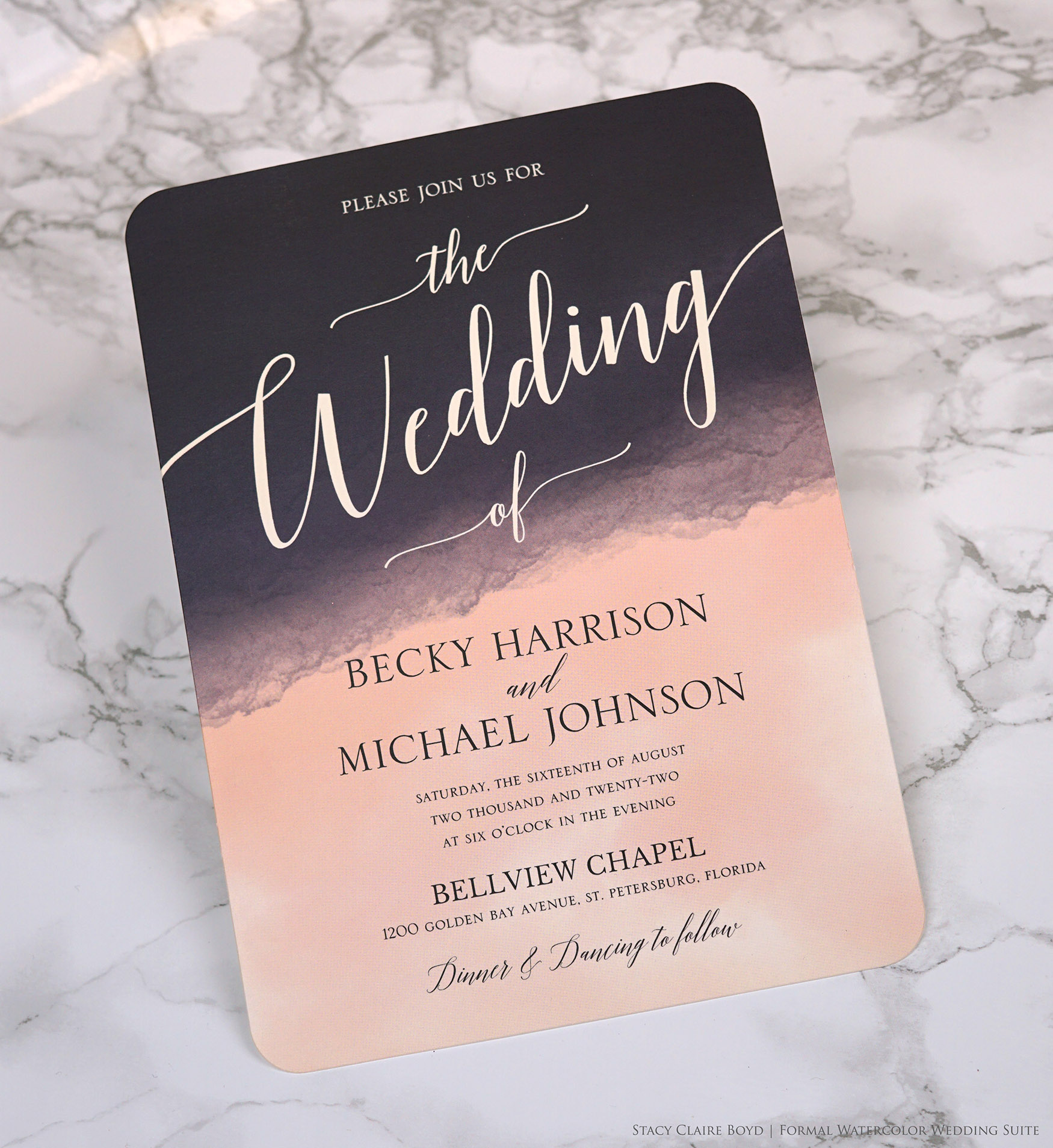 dramatic pink and navy watercolor wash is the background of this contemporary wedding invitaiton