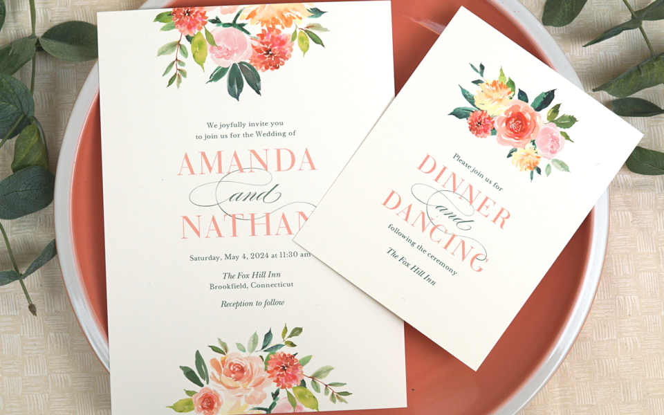 spring Romance flat printed wedding invitation collection features a beautiful watercolor floral motif in shades of green, coral, and pink.