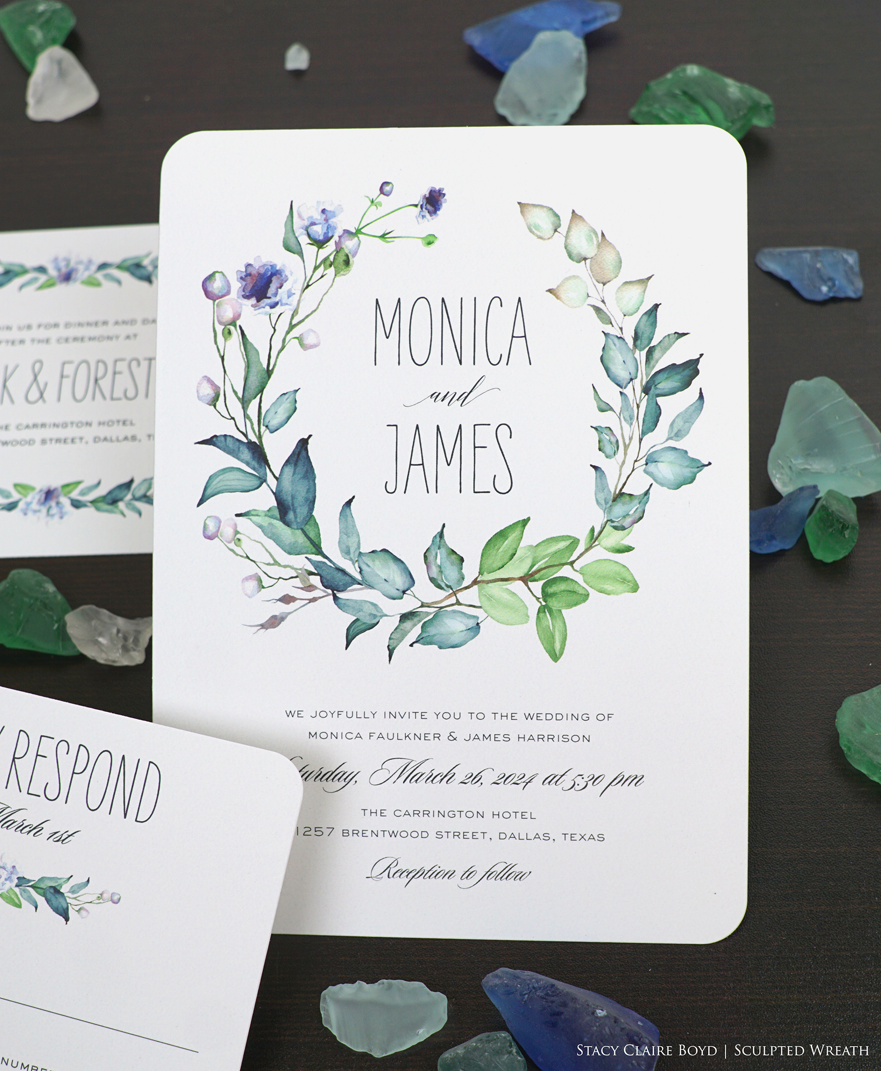 Sculpted Wreath wedding invitation features beautiful dusty blues, greens, and purples