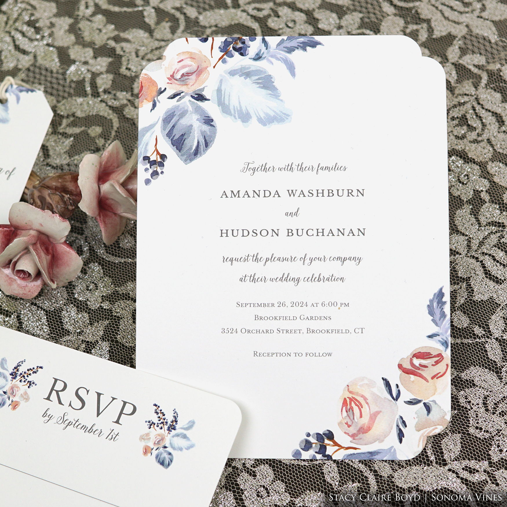 Sonoma Vines wedding invitation features folk-art style watercolor flowers in blues, lavenders, and rose colors.